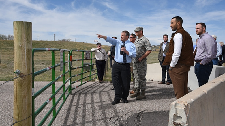 Todd Eldridge, F.E. Warren Enhanced Use Lease project manager, points out the boundaries of the land being considered for development as part of Industry Day at F.E. Warren Air Force Base, Wyo., April 18, 2017. 74 acres on the south border of the base are being opened to public bid for development as part of the EUL. More than thirty individuals came to the event, representing more than 15 property-development organizations. (U.S. Air Force photo by Glenn S. Robertson)