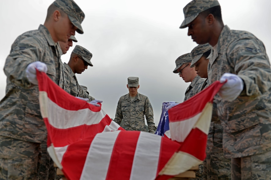 U.S. Airmen assigned to the 20th Force Support Squadron honor guard practice flag-folding techniques at Shaw Air Force Base, S.C., April 20, 2017. Honor guardsmen provide services such as flag-folding ceremonies, the presentation of colors and firing parties while representing the U.S. Air Force both on- and off-base. (U.S. Air Force photo by Airman 1st Class Destinee Sweeney)