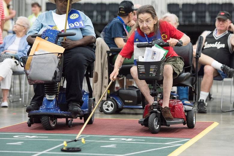 A veteran lines up her shot during a shuffleboard competition during the 2016 National Veterans Golden Age Games in Detroit. The 2017 NVGAG will take place from May 7-11, 2017, in Biloxi, Miss. Credit: (Veterans Affairs photo)