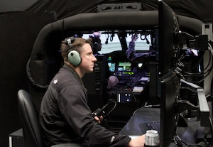 Chief Warrant Officer 2 Travis Vanlengen, an Iowa Army National Guard UH-60M instructor pilot with Company C, 2nd Brigade, 147th Aviation Battalion, of Boone, Iowa, and a certified Black Hawk Aircrew Trainer instructor-operator, monitors a pilot's flight at the Camp Dodge Joint Maneuver Training Center, in Johnston, Iowa. The instructor-operator's screens allow him to see the pilot inside the aircraft, as well as watch their flight path on a map, while controlling stress factors, such as inclement weather, enemy fire and mechanical failures. Vanlengen said these safety hazards are possible, both in peacetime and at war, and can be fatal without the proper training.
