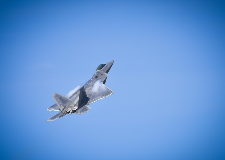A U.S. Air Force F-22 Raptor, flies during ATLANTIC TRIDENT 17 at Joint Base Langley-Eustis, Va., April 17, 2017. The F-22, which is capable of receiving information from a multitude of airborne and ground based platforms, directs other assets to aid in mission success or away from potential threats. (U.S. Air Force photo/Airman 1st Class Anthony Nin Leclerec)