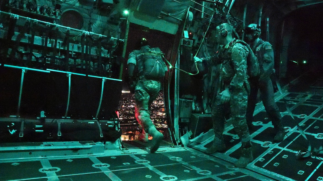 Air Force Special Operations, Survival, Evasion, Resistance and Escape specialists jump from a C-130 Hercules aircraft during a high altitude low opening parachute drop over Yokota Air Base, Yokota Air Base, Japan, April 13, 2017. Air Force photo by Machiko Arita