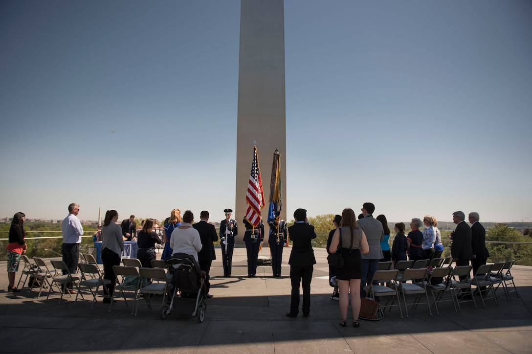 A U.S. Air Force Color Guard presents the colors during a wreath laying ceremony at the Air Force Memorial in Arlington, Va., honoring the 75th Anniversary of the Doolittle Tokyo Raid Apr. 18, 2017. (Photo by Senior Master Sgt. Adrian Cadiz)(Released)