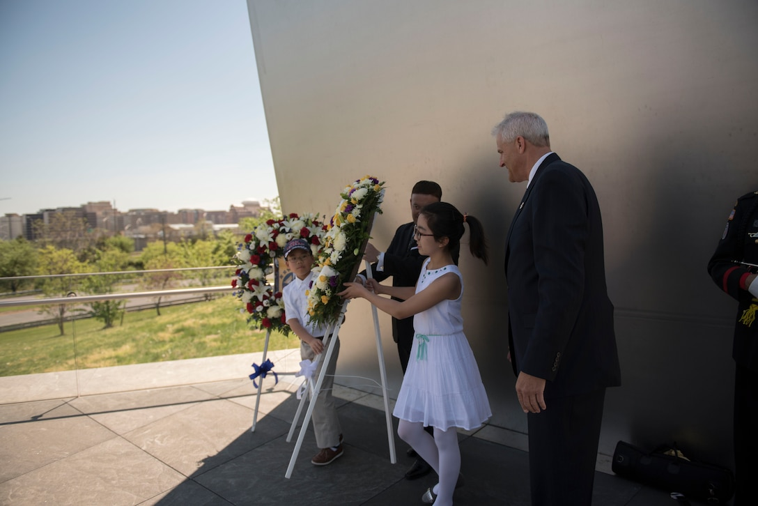 Two wreaths commemorating the 75th Anniversary of the Doolittle Tokyo Raid are placed at the Air Force Memorial in Arlington, Va., during a wreath laying ceremony Apr. 18, 2017. (Photo by Senior Master Sgt. Adrian Cadiz)(Released)