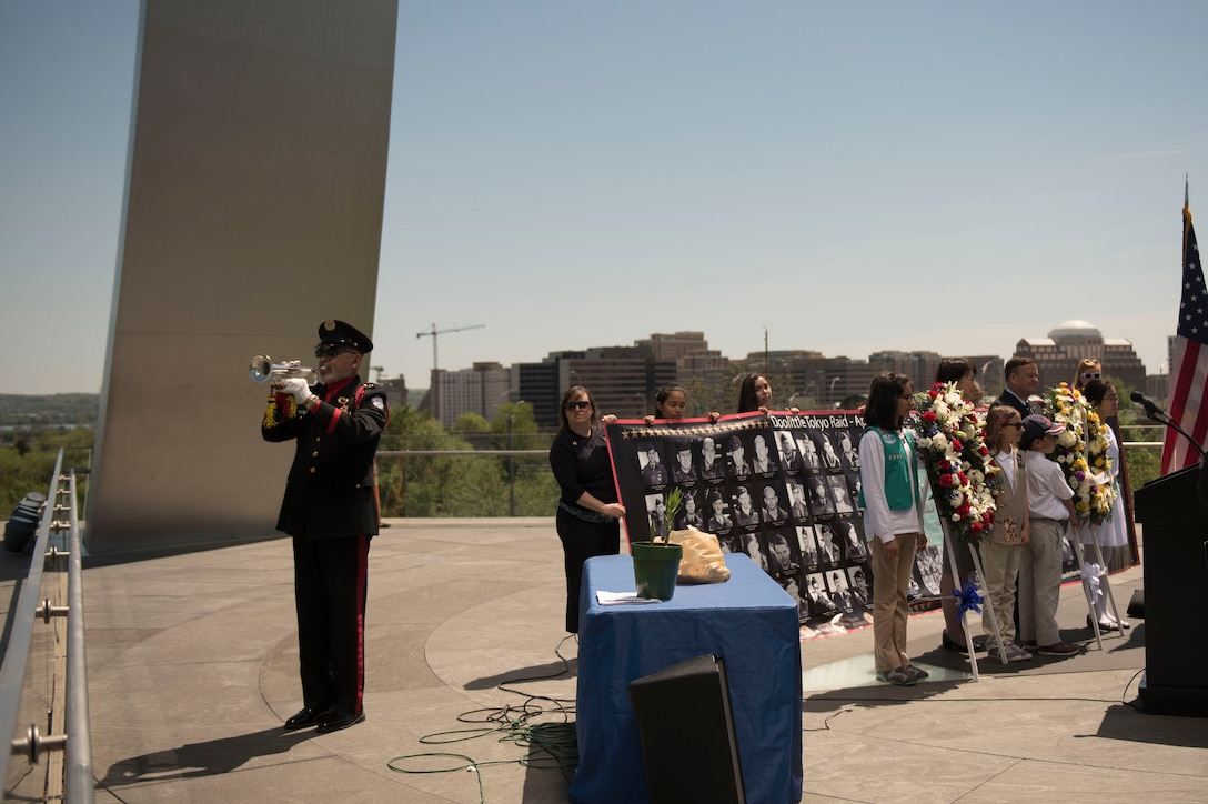 Mr. Auston O'Neill of Bugles Across America plays Taps during a wreath laying ceremony honoring the 75th Anniversary of the Doolittle Tokyo Raid at the Air Force Memorial in Arlington, Va., Apr. 18, 2017. (Photo by Senior Master Sgt. Adrian Cadiz)(Released)