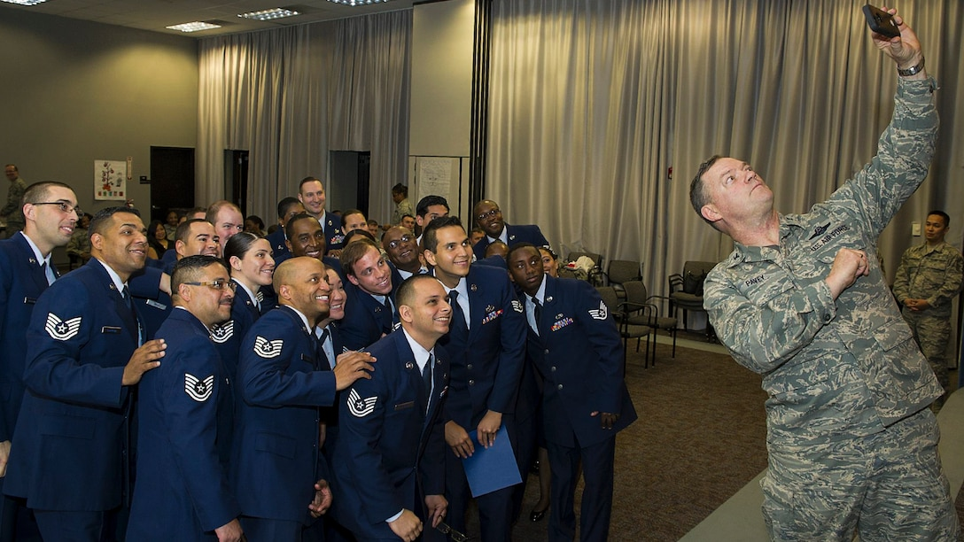 Twenty three junior non-commissioned officers smile for a selfie after graduating  from a leadership development course at Joint Base McGuire-Dix-Lakehurst, N.J., April 14, 2017. The airmen are assigned to the 514th Air Mobility Wing. Air Force photo by Christian DeLuca
