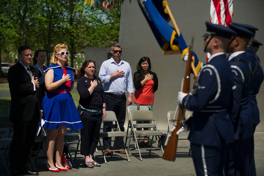 Guest at a wreath laying ceremony honoring the 75th Anniversary of the Doolittle Tokyo Raid render honors as the colors are presented during the ceremony at the Air Force Memorial in Arlington, Va., Apr. 18, 2017. (Photo by Senior Master Sgt. Adrian Cadiz)(Released)