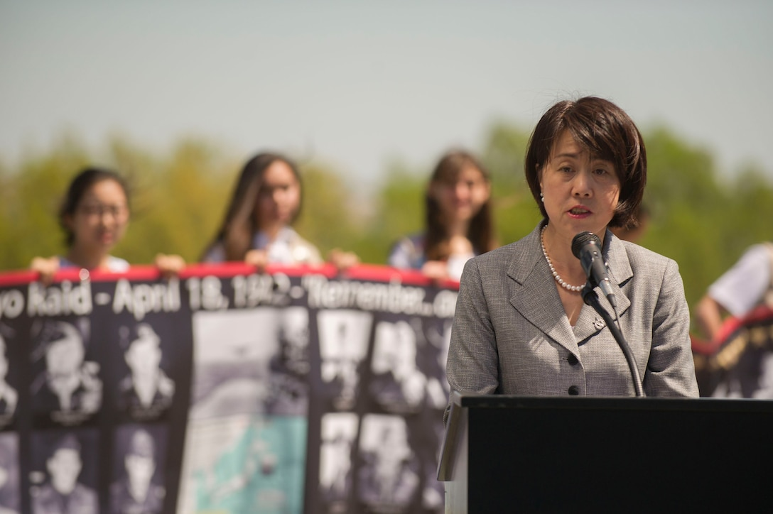 Ms. Wang Yuehong, Counselor, Chines Embassy delivers remarks during a wreath laying ceremony honoring the 75th Anniversary of the Doolittle Tokyo Raid at the Air Force Memorial in Arlington, Va., Apr. 18, 2017. Counselor Yuehong spoke of the contributions made by Chinese civilians that assisted the Raiders once they landed in China. (Photo by Senior Master Sgt. Adrian Cadiz)(Released)