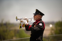 Mr. Auston O'Neill from Bugles Across America plays Taps during a wreath laying ceremony at the Air Force Memorial in Arlington, Va., honoring the 75th Anniversary of the Doolittle Tokyo Raid Apr. 18, 2017. (Photo by Senior Master Sgt. Adrian Cadiz)(Released)