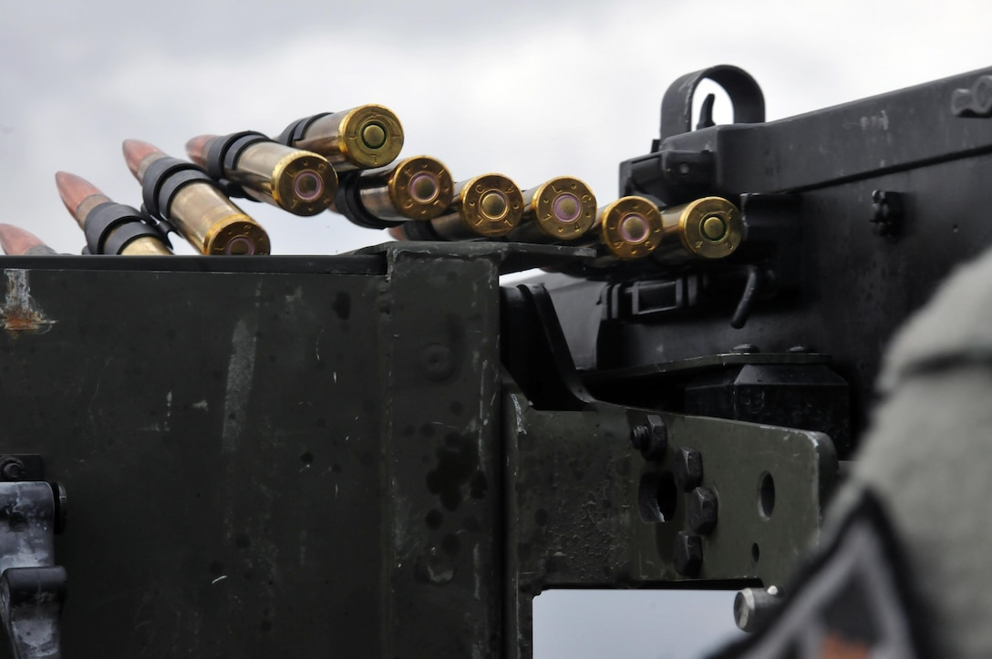 Rounds from a M2 50-caliber machine gun bounce as they are fed into the weapon as a U.S. Army Reserve Soldier with the 979th Mobility Augmentation Company (MAC), 478th Engineer Battalion, 926th Engineer Brigade, 412th Theater Engineer Command (TEC), based in Lexington, Ky., engages a target during a live-fire gunnery qualification at Wilcox Range on Fort Knox, Ky., March 28, 2017. (U.S. Army Reserve photo by Sgt. 1st Class Clinton Wood).
