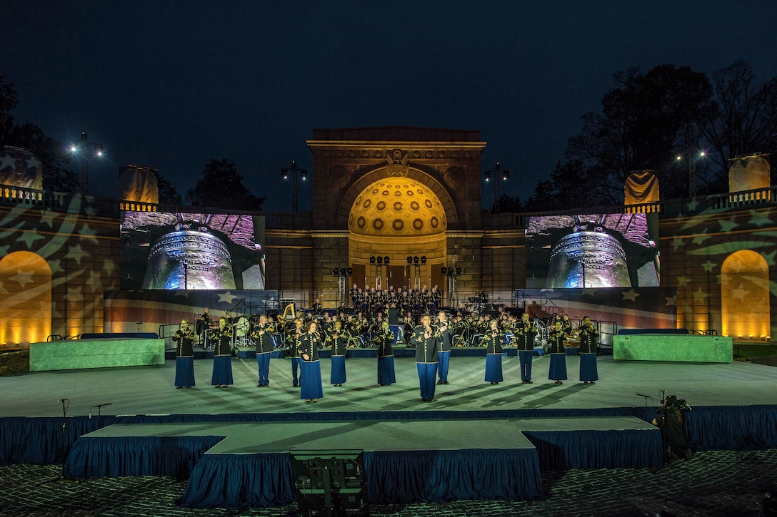 Soldiers rehearse for a public concert hosted by the U.S. Army Military District of Washington at the Women in Military Service for America Memorial at Arlington National Cemetery, Va., April 20, 2017. The show honors and celebrates the contributions of soldiers, first responders, nurses and teachers. DoD photo by EJ Hersom