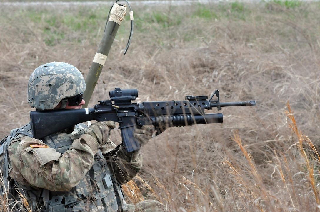 """U.S. Army Reserve Pvt. Jamie Johnson with the 979th Mobility Augmentation Company, 478th Engineer Battalion, 926th Engineer Brigade, 412th Theater Engineer Command, based in Lexington, Ky., engages targets in a """"react to contact"""" drill during the company's training at Wilcox Range on Fort Knox, Ky., March 30, 2017. Johnson was carrying a Bangalore torpedo which he and another Soldier teamed up to detonate. This was part of Engineer Qualification Table (EQT) VIII. The company went on to be certified in EQT XII becoming the first U.S. Army Reserve unit to accomplish this feat. (U.S. Army Reserve Photo by Sgt. 1st Class Clinton Wood)"""