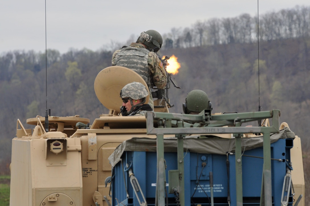 A U.S. Army Reserve Soldier with the 979th Mobility Augmentation Company, 478th Engineer Battalion, 926th Engineer Brigade, 412th Theater Engineer Command, based in Lexington, Ky., engages a target with his M240B machine gun loaded with blank rounds during Engineer Qualification Table (EQT) VII at Wilcox Range on Fort Knox, Ky., April 1, 2017. The company went on to become certified in EQT XII which made it the first U.S. Army Reserve unit to accomplish this feat.  (U.S. Army Reserve Photo by Sgt. 1st Class Clinton Wood)