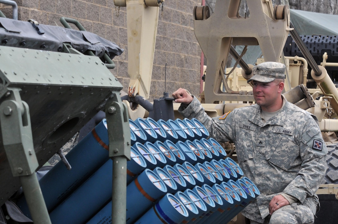 U.S. Army Reserve Cpl. Nicholas Vahle with the 979th Mobility Augmentation Company, 478th Engineer Battalion, 926th Engineer Brigade, 412th Theater Engineer Command, based in Lexington, Ky., pauses to look at 40 training mine canisters in one panel of a M136 Volcano weapons system during the company's training at Wilcox Range on Fort Knox, Ky.,April 1, 2017. This was part of Engineer Qualification Table XII. This company was the first U.S. Army Reserve unit to accomplish this feat. (U.S. Army Reserve Photo by Sgt. 1st Class Clinton Wood)