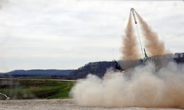 The MK22 Mod 4 rocket from a Mine Clearing Line Charge belonging to the 979th Mobility Augmentation Company, 478th Engineer Battalion, 926th Engineer Brigade, 412th Theater Engineer Command, based in Lexington, Ky., launches during the company's training at Wilcox Range on Fort Knox, Ky., April 1, 2017. This was part of Engineer Qualification Table XII. This company was the first U.S. Army Reserve unit to accomplish this feat. (U.S. Army Reserve Photo by Sgt. 1st Class Clinton Wood)