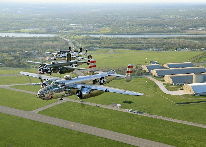 DAYTON, Ohio (04/2017) -- Four B-25 Mitchell bombers fly over the National Museum of the U.S. Air Force as part of the 75th Anniversary of the Doolittle Tokyo Raid. The aircraft pictured here are Panchito, Betty's Dream, God and Country, and Barbie III. (Photo courtesy of Greg Morehead from Warbird Digest)