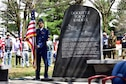 DAYTON, Ohio (04/2017) -- A cadet from the Air Force Academy stands next the Doolittle Tokyo Raiders memorial  in honor of the Doolittle Raiders 70th Anniversary Reunion, which was held at the National Museum of the U.S. Air Force on April 17-18, 2017. (U.S. Air Force photo by Ken LaRock)