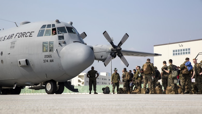 U.S. Marines with Marine Attack Squadron (VMA) 311 board a C-130 Hercules during an exercise to Kunsan Air Base, Republic of Korea, from Marine Corps Air Station Iwakuni, Japan, April 12, 2017. VMA 311 is participating in Exercise MAX THUNDER 17, an operational readiness exercise built to promote interoperability between U.S. and ROK forces. This annual exercise helps to promote stability in the Asia-Pacific region.