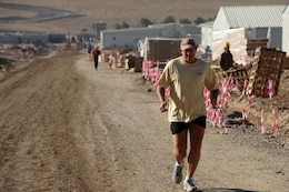 Jimmy Waddle, U.S. Army Corps of Engineers resident engineer for construction work at Mosul Dam, Iraq participates in a 5k run at the dam Nov. 24, 2016.  He frequently exercised to stay in shape while leading the effort to construct a housing complex, drill and grout the foundation of the dam, and inspect and repair the bottom outlet tunnels and equipment. Waddle returned to the U.S. Army Corps of Engineers Nashville District in March 2017 where he serves as chief of the Engineering and Construction Division.