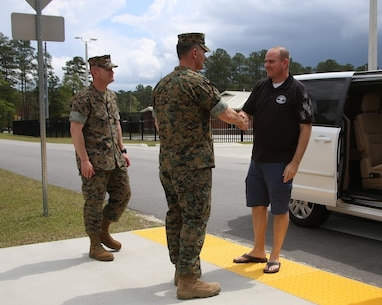 Sgt. Maj. Marinica Ariton, left, and Lt. Col. Jeremy Winters, center, welcome Will Lewis, mayor of Havelock to the Marine Air Support Squadron 1 facilities at Marine Corps Air Station Cherry Point, N.C., April 14, 2017. Lewis was accompanied by former MASS-1 Marine, Mark Carter, during a tour of the MASS-1 facilities. MASS-1, Marine Air Control Group 28, 2nd Marine Aircraft Wing, is responsible for the planning, receiving, coordination and processing of requests for direct or close air support. Winters is the commanding officer of MASS-1 and Ariton is the squadron sergeant major. (U.S. Marine Corps photo by Sgt. N.W. Huertas/Released)