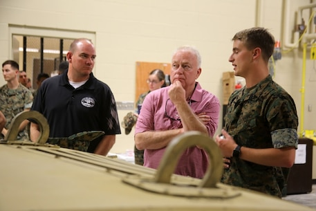 Will Lewis, mayor of Havelock, left, and Marine Mark Carter are briefed by Cpl. Matthew Foley during a tour at Marine Corps Air Station Cherry Point, N.C., April 14, 2017. Carter and Lewis toured the Marine Air Support Squadron 1 facilities and had a first-hand look at the squadron's mission. MASS-1, Marine Air Control Group 28, 2nd Marine Aircraft Wing, is responsible for the planning, receiving, coordination and processing of requests for direct or close air support. Foley is a communications maintenance noncommissioned officer with the  unit. (U.S. Marine Corps photo by Sgt. N.W. Huertas/Released)