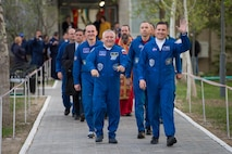 Expedition 51 crew members, Fyodor Yurchikhin, the Soyuz commander of Roscosmos (left) and Col. Jack Fischer, NASA flight engineer (right) wave to family and friends as they depart the Cosmonaut Hotel to suit-up for their Soyuz launch to the International Space Station April 20, 2017, in Baikonur, Kazakhstan. The Soyuz rocket launched at 1:13 p.m. April 20, and sent Yurchikhin and Fischer on a four and a half month mission aboard the International Space Station. (NASA photo/Aubrey Gemignani)