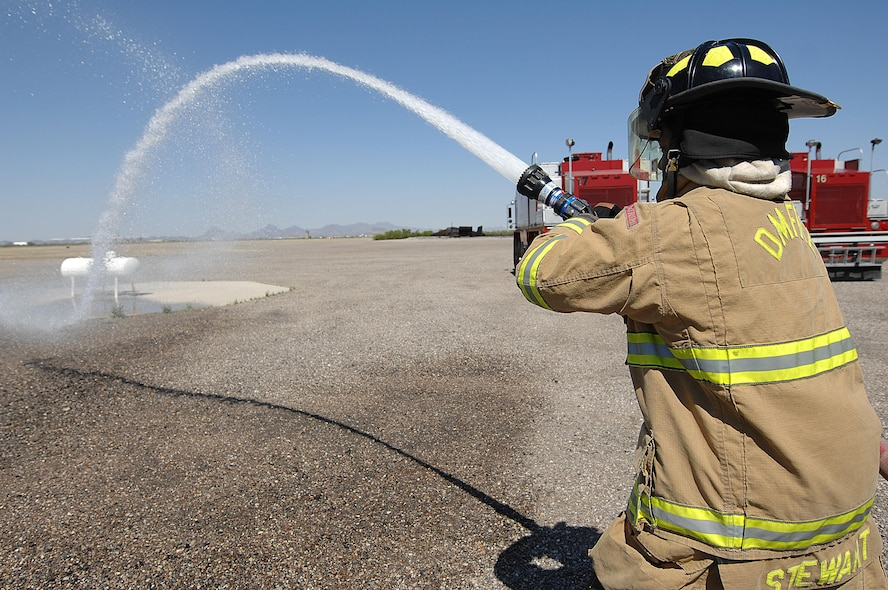 U.S. Air Force Senior Airman Haji Stewart, 355th Civil Engineering Squadron firefighter, participates in a fire attack drill at Davis-Monthan Air Force Base, Ariz., April 19, 2017. D-M firefighters continuously train throughout the week in order to keep their skills honed. (U.S. Air Force photo by Airman 1st Class Frankie Moore)