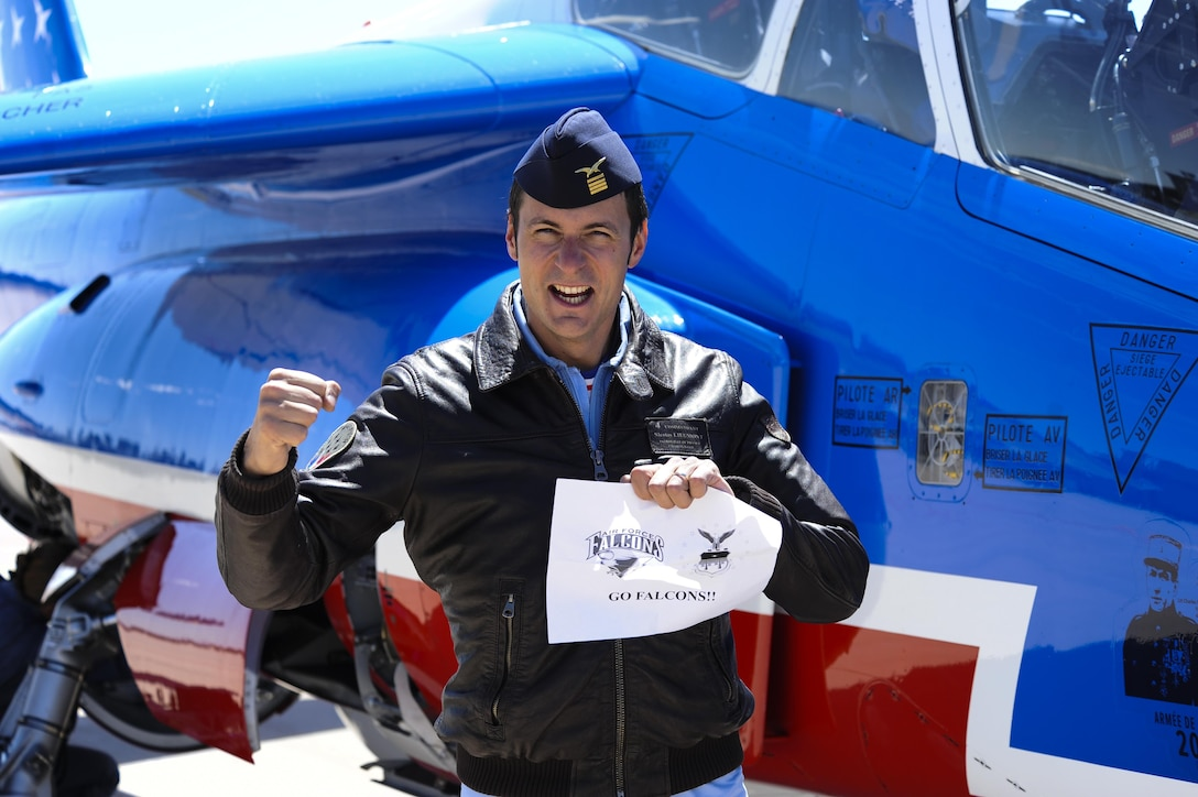 French air force Maj. Nicolas Lieumont, Patrouille France pilot, shows his Falcon spirit after flying over the U.S. Air Force Academy, Colorado, April 19, 2017. Lieumont was an exchange student at the Academy in 2004. (U.S. Air Force photo/Tech. Sgt. Julius Delos Reyes)