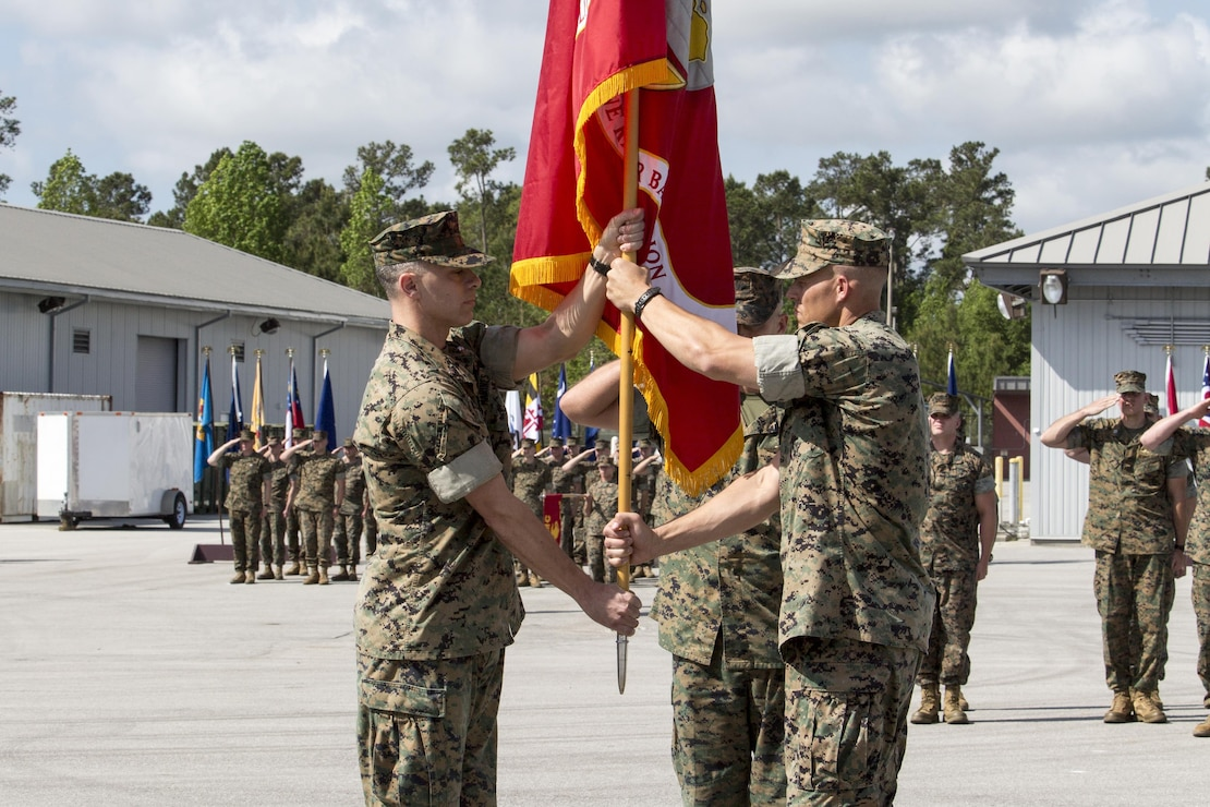 Lt. Col. William L. Lombardo assumes command of 2d Marine Raider Battalion, U.S. Marine Corps Forces, Special Operations Command, from Lt. Col. Craig A. Wolfenbarger during a change of command ceremony aboard Courthouse Bay, Marine Corps Base Camp Lejeune, N.C., April 20, 2017. The exchange of the organizational colors symbolizes Wolfenbarger relinquishing his responsibilities as commanding officer of the battalion to Lombardo.  Lombardo assumes command after serving with MARSOC Headquarters, G-7 Training and Education Branch. (U.S. Marine Corps photo by Sgt. Salvador R. Moreno)