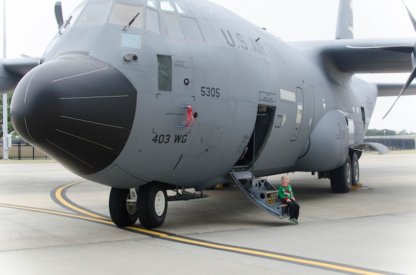 Nathan Heiney, son of Senior Airman Brian Heiney, 403rd Security Forces Squadron and Staff Sgt. Heather Heiney, 403rd Wing Public Affairs, sees a WC-130J Super Hercules aircraft up-close for the first time during the 403rd Wing children's holiday party Dec. 12 at Keesler Air Force Base, Mississippi. (U.S. Air Force photo/Staff Sgt. Heather Heiney)