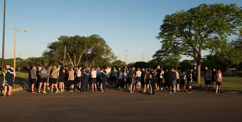 Participants of the Arbor Day and Earth Day 5K fun run gather at the starting line at Unity Park on Cannon Air Force Base, NM, April 19, 2017. The run was just one event in the day in celebration of Arbor Day for the base, which was decreed to be April 19 by Col. Douglas Gilpin, 27th Special Operations Mission Support Group commander. (U.S. Air Force photo by Staff Sgt. Michael Washburn/Released)