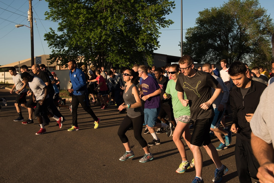 Members of Cannon Air Force Base, NM, start running during the Arbor Day and Earth Day 5K fun run at Unity Park, April 19, 2017. The run was just one event in the day in celebration of Arbor Day for the base, which was decreed to be April 19 by Col. Douglas Gilpin, 27th Special Operations Mission Support Group commander. (U.S. Air Force photo by Staff Sgt. Michael Washburn/Released)