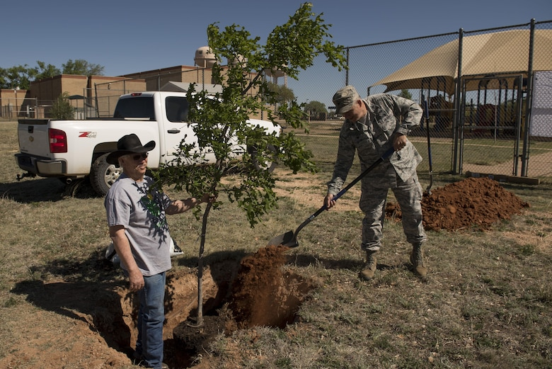 Col. Douglas Gilpin, 27th Special Operations Mission Support Group commander, throws the first mound of dirt during the Arbor Day and Earth Day tree planting ceremony at the Youth Center on Cannon Air Force Base, NM, April 19, 2017. The tree planting was one of three events themed after Earth Day and also Arbor Day, which was decreed to be April 19 at Cannon by Gilpin. (U.S. Air Force photo by Staff Sgt. Michael Washburn/Released)