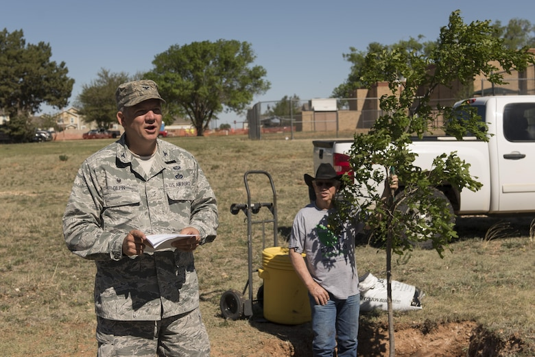 Col. Douglas Gilpin, 27th Special Operations Mission Support Group commander, says the closing remarks at the Arbor Day and Earth Day tree planting ceremony at the Youth Center on Cannon Air Force Base, NM, April 19, 2017. Along with the tree planting, Cannon also held a 5K fun run and a recycling center demonstration. (U.S. Air Force photo by Staff Sgt. Michael Washburn/Released)