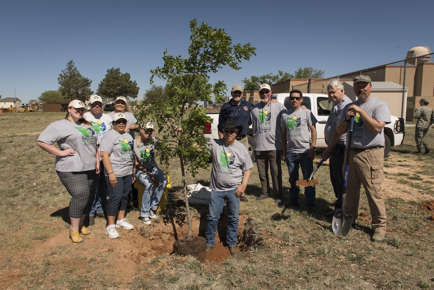 Members of the 27th Special Operations Civil Engineer Squadron Environmental Office pose for a photo after the Arbor Day and Earth Day tree planting ceremony at the Youth Center on Cannon Air Force Base, NM, April 19, 2017. Small Afghan Pine trees, along with t-shirts, were available for anyone to take that came to the ceremony. (U.S. Air Force photo by Staff Sgt. Michael Washburn/Released)