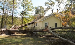 A huge tree uprooted by Hurricane Matthew fell through the roof of this home near Princeville, North Carolina. Severe flooding from the storm caused $4.8 billion in damages to homes, businesses and infrastructure in NC alone. (Photo: Courtesy Hank Heusinkveld, Public Affairs Specialist, USACE-Wilmington.)