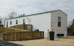 A FEMA Manufactured Housing Unit used as temporary quarters for individuals displaced by a natural disaster. The 1-3 room furnished units, complete with utilities, conform to the U.S. Department of Housing and Urban Development standards and FEMA contract requirements. Eligible applicants can reside in such units for up to 18 months after the declaration of a federal disaster.