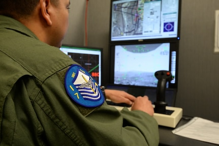 Master Sgt. Alex, one of the first Enlisted Pilot Initial Class students, operated the controls for a simulator during the Remotely Piloted Aircraft Fundamentals Course at Joint Base San Antonio-Randolph, Texas, April 19, 2017. Alex is assigned to Undergraduate Remotely Piloted Training Class 17-10, 558th Flying Training Squadron. (U.S. Air Force photo by Tech. Sgt. Ave I. Young) The Undergraduate Remotely Piloted Training Class 17-10 patch is worn by all the students and was designed with the master sergeant insignia to represent the Enlisted Pilot Initial Class students. Master Sgt. Alex, one of the first Enlisted Pilot Initial Class students, operated the controls for a simulator during the Remotely Piloted Aircraft Fundamentals Course at Joint Base San Antonio-Randolph, Texas, April 19, 2017.