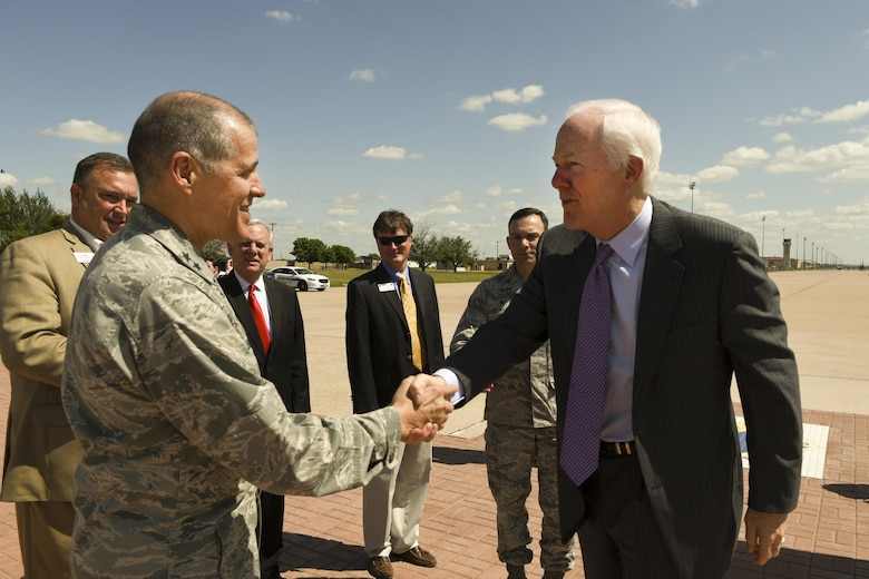 U.S. Sen. John Cornyn, R-TX, shakes hands with Maj. Gen. Thomas Bussiere, 8th Air Force commander, at Dyess Air Force Base, Texas, April 18, 2017. The purpose of the visit was to familiarize the senator with the base and its mission sets, get a glimpse at a day in the life of Team Dyess Airmen and meet with Abilene community leaders. (U.S. Air Force photo by Senior Airman Kedesha Pennant)