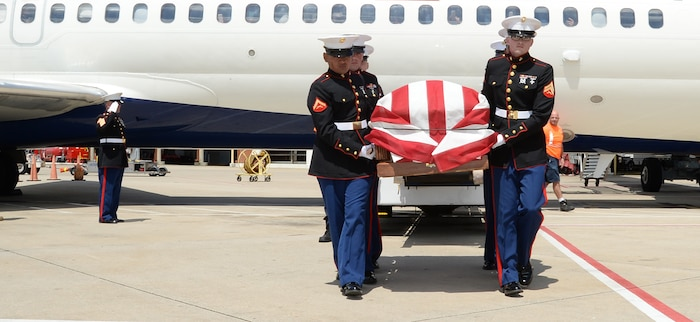 Gunnery Sgt. Melvin G. Ashley, escort, Funeral Detail, Marine Corps Logistics Base Albany, Ga., salutes as Marines carry the remains of fallen Marine Pfc. James O. Whitehurst to an awaiting hearse at the Tallahassee International Airport in Tallahassee, Fla., April 11. Whitehurst was killed in action at the battle of Tarawa during World War II, Nov. 20, 1943. In 2015 a private, non-profit organization known as History Flight excavated what is believed to be Cemetery 27 on the island of Betio, Tarawa, and recovered the remains of multiple individuals, one of them being Whitehurst.