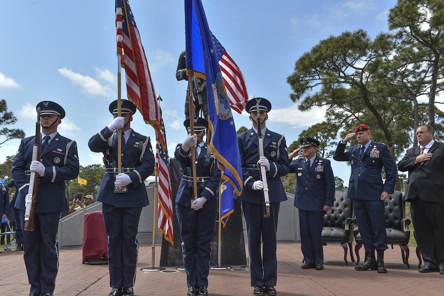 The Hurlburt Field Honor Guard present the colors during a dual Air Force Cross ceremony at Hurlburt Field, Fla., April 20, 2017. For the first time in Air Force history, two Airmen were simultaneously awarded the service's highest medal for valorous action in combat. Master Sgt. (Ret.) Keary Miller, a retired Special Tactics pararescueman from the Air National Guard's 123rd Special Tactics Squadron, and Chris Baradat, a combat controller since separated, both received Silver Star medals for their actions in combat, which were upgraded after a service-wide review. (U.S. Air Force photo by Senior Airman Ryan Conroy)