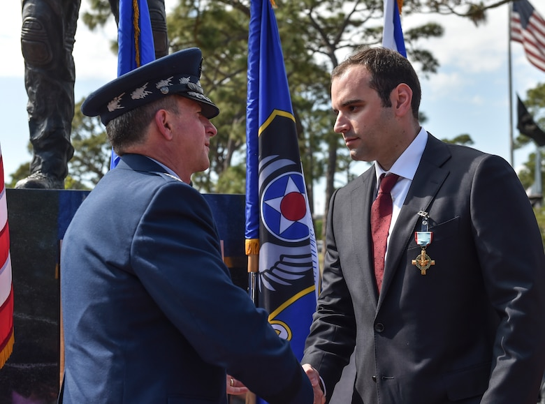 Chief of Staff of the Air Force, Gen. David L. Goldfein, presents Chris Baradat, a combat controller since seperated, the Air Force Cross at Hurlburt Field, April 20, 2017. For the first time in Air Force history, two Airmen were simultaneously awarded the service's highest medal for valorous action in combat. Master Sgt. (Ret.) Keary Miller, a retired Special Tactics pararescueman from the Air National Guard's 123rd Special Tactics Squadron, and Baradat both received Silver Star medals for their actions in combat, which were upgraded after a service-wide review. (U.S. Air Force photo by Senior Airman Ryan Conroy)