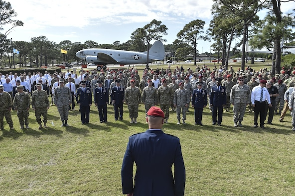 "Col. Michael E. Martin, the commander for the 24th Special Operations Wing, calls Airmen to attention to perform ""Memorial Pushups"" honoring the fallen following a dual Air Force Cross ceremony, April 20, 2017, at Hurlburt Field, Fla. Master Sgt. (Ret.) Keary Miller, a retired Special Tactics pararescueman from the Air National Guard's 123rd Special Tactics Squadron, and Chris Baradat, a combat controller since separated, both received Air Force Crosses for their actions in combat, which were upgraded from Silver Star medals after a service-wide review. (U.S. Air Force photo by Senior Airman Ryan Conroy)"