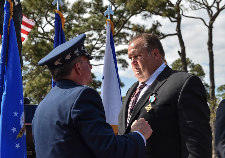 Chief of Staff of the Air Force, Gen. David L. Goldfein, presents Master Sgt. (Ret.) Keary Miller, a retired Special Tactics pararescueman, the Air Force Cross at Hurlburt Field, April 20, 2017. For the first time in Air Force history, two Airmen were simultaneously awarded the service's highest medal for valorous action in combat. Miller, from the Air National Guard's 123rd Special Tactics Squadron, and Chris Baradat, a staff sergeant combat controller at the time, both received Silver Star medals for their actions in combat, which were upgraded after a service-wide review. (U.S. Air Force photo by Senior Airman Ryan Conroy)