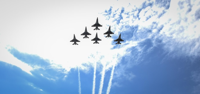 The U.S. Air Force Thunderbirds perform a flyover as the Pensacola Christian College choir sings the National Anthem during a dual Air Force Cross ceremony, April 20, 2017, at Hurlburt Field, Fla. For the first time in Air Force history, two Airmen were simultaneously awarded the service's highest medal for valorous action in combat. Miller, from the Air National Guard's 123rd Special Tactics Squadron, and Chris Baradat, a combat controller since separated, both received Silver Star medals for their actions in combat, which were upgraded after a service-wide review. (U.S. Air Force photo by Airman 1st Class Dennis Spain)