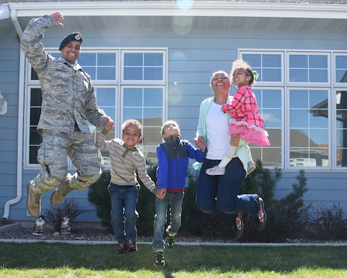 Tech. Sgt. Bennie Prescott, 341st Missile Security Forces Squadron physical security manager, his wife, Ellen and their children jump with excitement April 20, 2017, at Malmstrom Air Force Base, Mont. Bennie and Ellen included their kids on their journey to paying off $253,000 in debt in six years. (U.S. Air Force photo/Senior Airman Jaeda Tookes)