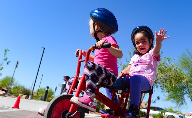 Children participate in the trike-a-thon at the Nellis Child Development Center on Nellis Air Force Base, Nev., April 14, 2017. The trike-a-thon was one of several activities held in April to celebrate the Month of the Military Child. (U.S. Air Force photo by Airman 1st Class Nathan Byrnes/Released)