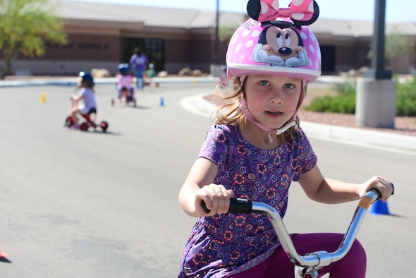 A child rides a tricycle during the trike-a-thon at the Nellis Child Development Center on Nellis Air Force Base, Nev., April 14, 2017. April is designated as the Month of the Military Child and is a way to celebrate the unique aspects of being a military child that most other children outside the military will never have to face. (U.S. Air Force photo by Airman 1st Class Nathan Byrnes/Released)