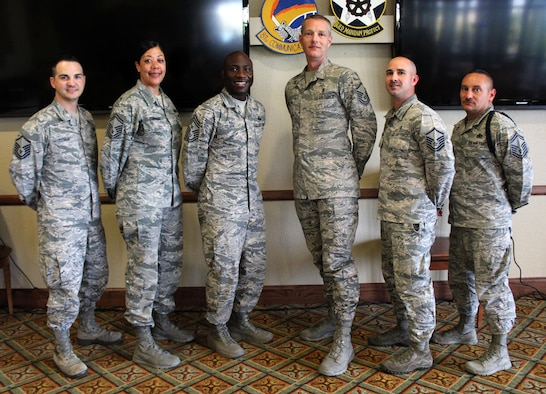 Members of the Keesler Top III executive council pose for a photo with Chief Master Sgt. Vegas Clark, 81st Training Wing command chief, after a meeting April 12, 2017, at the Bay Breeze Event Center on Keesler Air Force Base, Miss. Top III meetings take place the second Wednesday of the month at 3:30 p.m. in the BBEC's third floor Dragon's Lair.