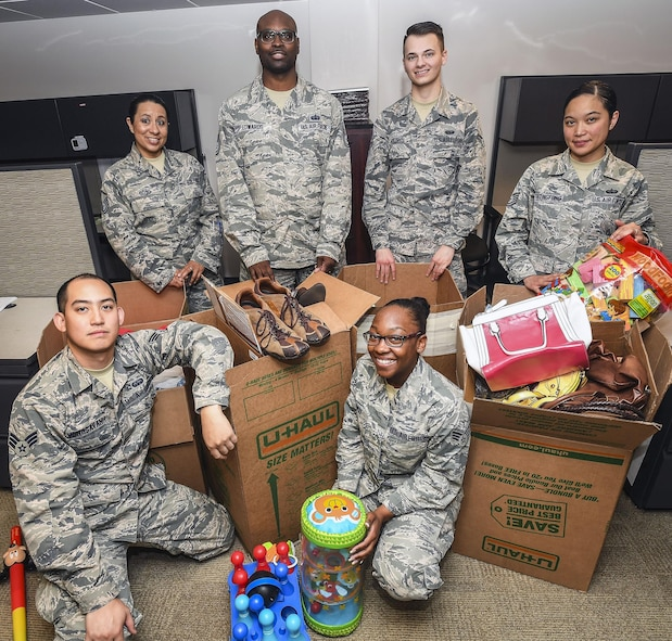Airmen pose for a photo April 19 at Hill Air Force Base. The Airmen organized a drive to collect cosmetics, clothing, blankets, children's toys and other items to benefit a local domestic violence shelter. Pictured are: front row, left to right, Senior Airman Matthew Vongsavanh and Senior Airman Taekausha Lomax; back row, left to right, Master Sgt. Vanessa Soto, Tech. Sgt. Gerald Edwards, Airman 1st Class Taylor Holdorf, and Tech. Sgt. Valarie Taitingfong. Not pictured are: Capt. Kristi Newberry, Tech. Sgt. Mary Mines, Senior Airman Fabian Ferretti, Senior Airman Douglas Crisp, Airman 1st Class Ian Padilla and Airman 1st Class Gavin Rucker. (U.S. Air Force photo)